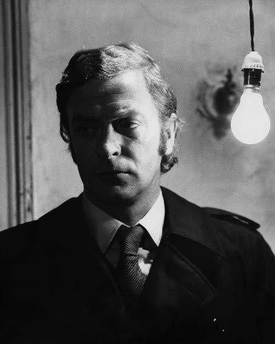 Michael Caine in Get Carter as Jack Carter in black raincoat standing by light bulb 8x10 Aluminum Wall Art