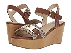 You crush the game in the G by Guess® Danna wedges.  Man-made upper.  Adjustable buckle closure at ankle.  Open-toe silhouette. Brandmark logo hardware at front.  Man-made lining and insole.  Lightly-padded insole for added comfort with each...