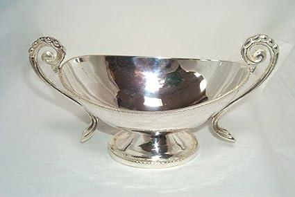 Elegante diseño en plata salsera en Empire