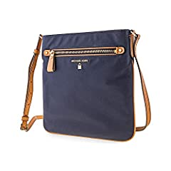 A Michael Kors Kelsey Cross-body bag styled in nylon with gold-tone hardware. This Cross-body features a back zip pocket, back slit pocket, 4 front slit pockets, front zip pocket, back snap pocket, a top-zip closure and a shoulder strap with ...