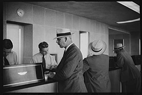 Photo: Washington,D.C. Passenger at the ticket office of the municipal airport - Hottest Ticket