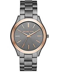 Watch Sizing Guide The gunmetal Michael Kors® Slim Runway watch is polished perfection. A classic three-link bracelet, rose gold-tone topring and monochromatic sunray dial with rose gold-tone stick indexes add up to a wear-with-everything ti...