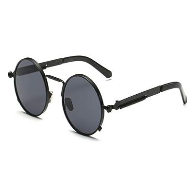 Gafas de sol redondas pequeñas de metal negro en el centro ...