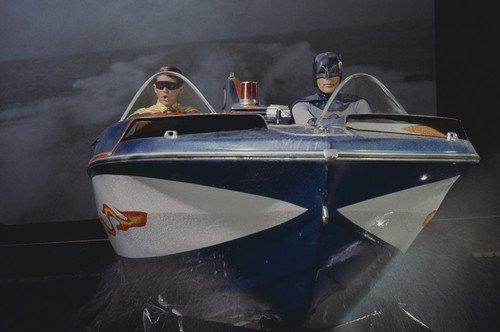 Adam West and Burt Ward in Batman in bat speed boat on TV set against backdrop 24x36 ()