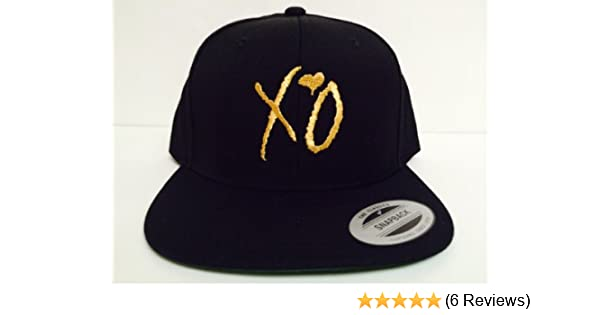 cfad7dcf7f488 Amazon.com  XO The Weeknd Gold Snapback Hat  Sports   Outdoors