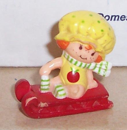 1982 Kenner Strawberry Shortcake Apple Dumplin On Sled Miniature Figure]()