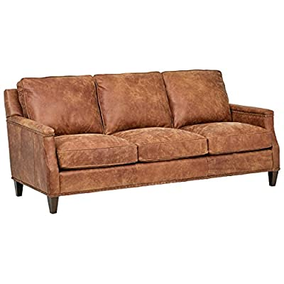 "Stone & Beam Marin Leather Nailhead Studded Sofa Couch, 87""W, Saddle Brown - Rich leather and clean lines accentuated by trim and nailhead detail will have this transitional sofa turning heads.  The loose back and plush seat cushions, and tapered wood legs, add to the sophisticated silhouette. This item is made to order just for you 87""W x 41""D x 37""H - sofas-couches, living-room-furniture, living-room - 4106Q5nx5jL. SS400  -"