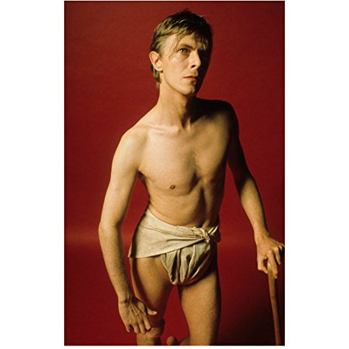 David Bowie Dressed in Loincloth Underwear and Stick Looking Up 8 x 10 Inch Photo]()