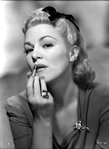 Claire Trevor Putting lipstick in Dress with Ring Photo Print (24 x 30)