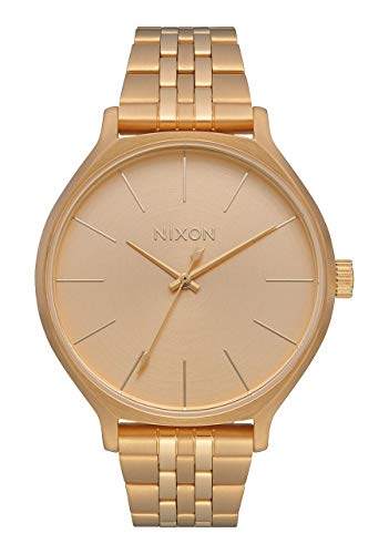 Nixon Clique Women's All Gold Fashion-Forward Jewelry-Style Watch (38mm. Gold Face/Gold Stainless Steel Band) from NIXON