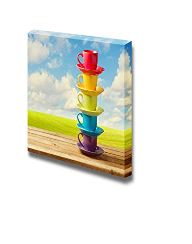 Rainbow Color Cups on Wooden Table over Beautiful Sky and Meadow Wall Decor ation