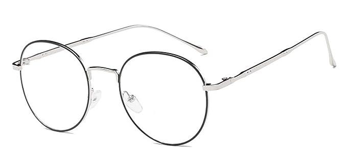 Gafas redondas de metal con lentes transparentes y contorno oscuro. Opción de otros diseños.