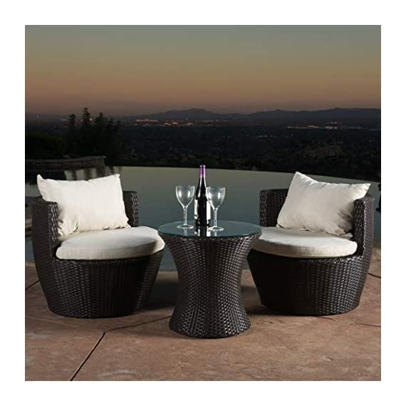 Christopher Knight Home 296323 Kyoto Outdoor Patio Furniture Brown Wicker 3-Piece Chat Set w/Cushions - Gather on the porch, patio or by the pool and catch some sun and good conversation with this three piece chat set. Brown wicker and beige weather resistant cushion covers combine for a classic, contemporary style sure to elevate your backyard style. A charming pedestal glass top table provides the perfect amount of surface space for holding cocktails and snacks. The sturdy Kyoto low back chairs feature back bolsters that offer superior lumbar support Includes: Two (2) Chairs, Two (2) Seat Cushions, Two (2) Back Bolsters, One (1) Table Materials: Wicker; Frame Material:  Aluminum - patio-furniture, patio, conversation-sets - 410Vf L2UJL. SS570  -