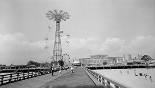 USA New York Coney Island Looking down Boardwalk towards Steeplechase Park showing parachute jump and beach Poster Print (18 x 24) (Island Steeplechase Coney)