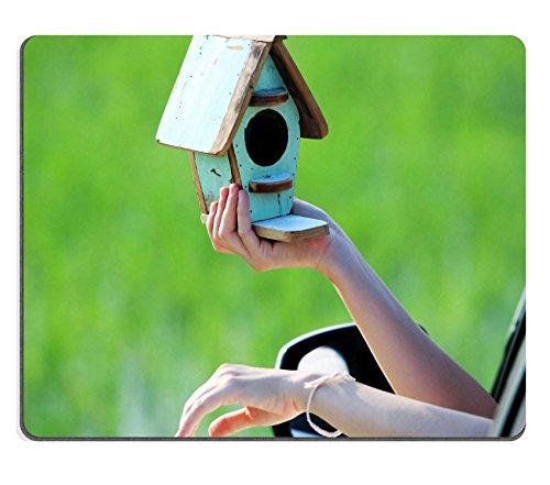 Msd Mousepad Image 21567170 Woman Holding Bird House Outside Window S Car