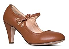Cute and adorable low round toe shoes are an easy everyday basic to complete your look. This retro vintage trend has become a basic wardrobe staple. This comfortable and easy pair of Pixie Low Kitten Heels by J. Adams makes it easy to add a v...