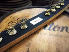 Celebrate Bourbon Heritage Month with a Blanton's bourbon barrel stave and limited edition set of gold stoppers!