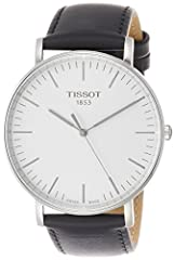 Stainless steel case with a black leather strap. Fixed stainless steel bezel. Silver dial with silver-tone hands and index hour markers. Minute markers around the outer rim. Dial Type: Analog. Tissot calibre ETA 902.101 quartz movement. Scrat...