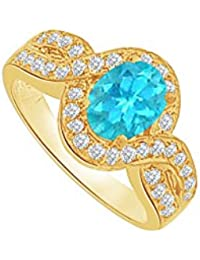 December Birthstone Blue Topaz and CZ Split Shank Ring