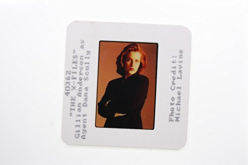 Slides photo of Gillian Leigh Anderson as factor Dana Scully in THE X-FILES film.