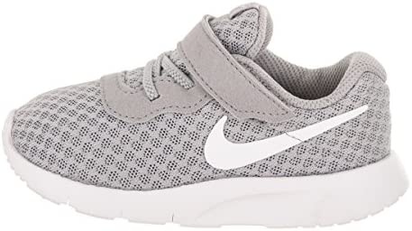 4112MkbQpEL. AC Nike Boy's Tanjun Running Shoes    The versatile Nike Tanjun is a casual and comfortable model. They feature a a breathable mesh upper, padded collar/tongue, fabric lining, and a phylon midsole/outsole.