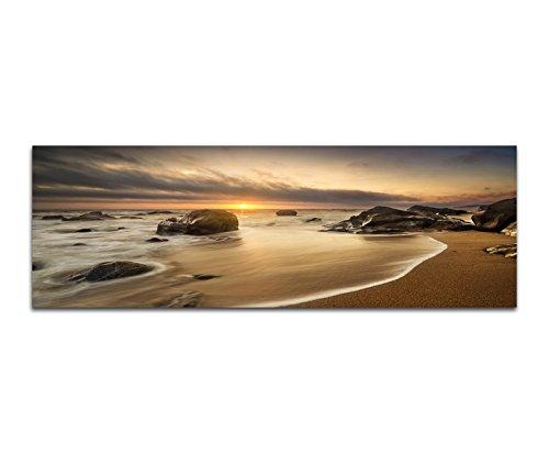 Panoramabild auf Leinwand und Keilrahmen 150x50cm Meer Strand Steine Sonnenaufgang Wolken