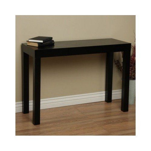 Sofa Table Wood Black with a Fine Glossy Finish. This Wood Coffee Table Is of Fine Material. A Sure Quality. A Great Addition to Your Dinning Room or Home Office Accessories. A Single Storage Drawer Is Included Adding Extra Value to This Fine Piece.