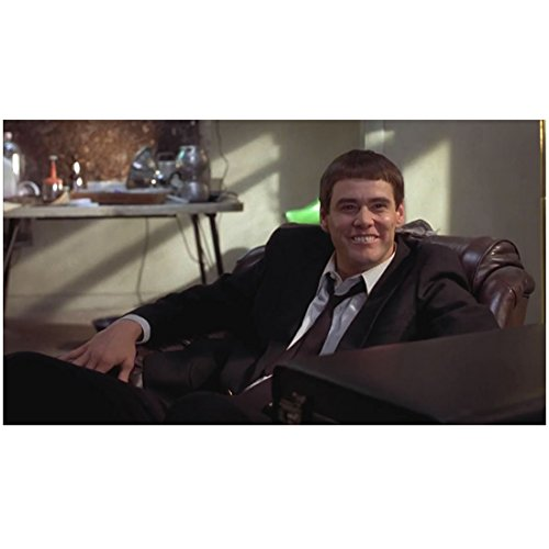 Dumb & Dumber (1994) 8 inch x 10 inch PHOTOGRAPH Jim Carrey Smiling Wearing Suit w/Loosened Tie Sitting in Brown Chair (Jim Carrey Dumb And Dumber Suit)