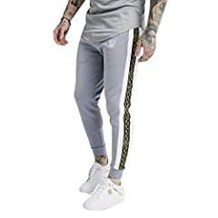 The Sik Silk Panelled Racer Cuffed Joggers in Grey, comes in a cropped skinny fit. Features drawstring waistband, side slant pockets, Cartel tapping down the legs, elastic cuff on leg hem. Finished with the Embroidered Sik Silk Logo.