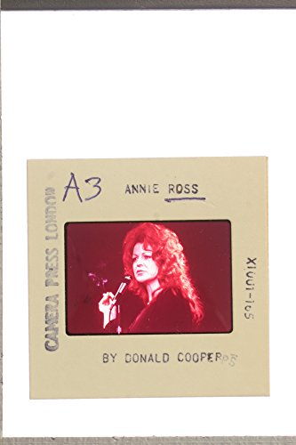 - Slides photo of Annie Ross singing on the microphone with a cigarette in her hand.