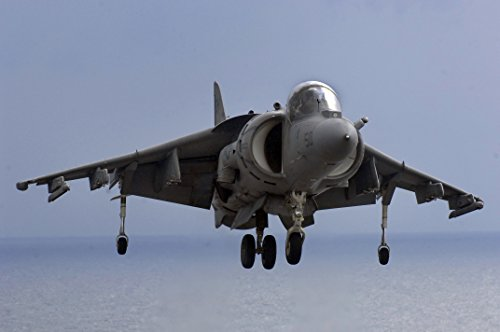 A Marine AV-8B Harrier aircraft from the 26th Marine Expeditionary Unit hovers above the flight deck Comfort Notting Hill