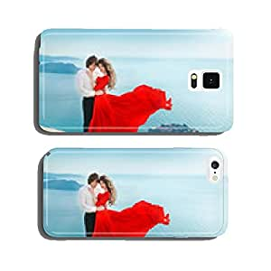 Romantic young couple in love over sea shore background. Fashion cell phone cover case Samsung S6