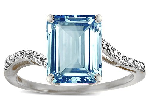 (Star K Big Stone Octagon Emerald Cut 10x8 Sky Blue Topaz Bypass solitaire ring 14 kt White Gold Size 6.5)