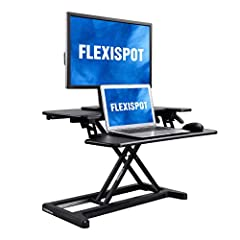 General Description  Transform your traditional desk into an active sit-stand workstation with FlexiSpot's desk riser. This unique standing desk converter sets itself apart from other desk risers with a one-of-a-kind, u-shaped design that exp...
