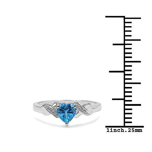 ed359605ab64 Durable Modelando La Colección Anillo Topacio   Anillo Oro Blanco 9ct con  corazón de Topacio Azul