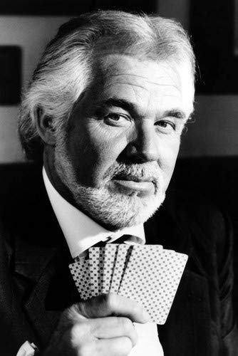 Kenny Rogers in Kenny Rogers as The Gambler holding his playing cards 24x36 Poster
