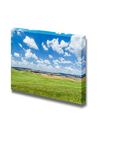 Scenic Tuscany landscape with rolling hills and beautiful cloudscape in Val d Orcia Italy Wall Decor ation