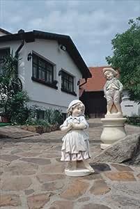 Niño con diseño de traje jardín Estatua (pintado a mano) mecanismo para jardín fabricado en hormigón piedra figuras figura decorativa escultura de jardín: Amazon.es: Hogar