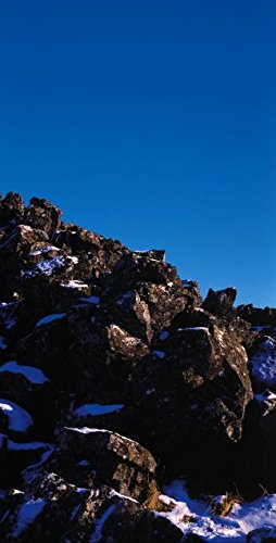 A Close Up of Brown Rocks under a Clear Blue Sky in Iceland 30x40 photo reprint by PickYourImage