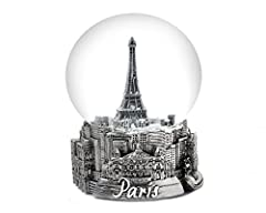 "Exclusive 65mm Paris Snow Globe featuring ""The Eiffel Tower"" and Paris destinations around the base. Measure 4 inches in height and 8 inches around the globe. These inspired piece makes a great addition to your collection. Each globe measures..."