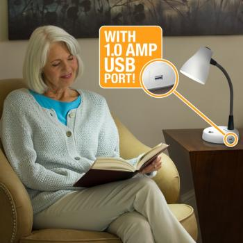 Older woman reading by the light of a Verilux Tazza Natural Spectrum Productively Desk Lamp