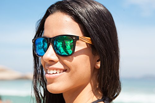 Woodies Zebra Wood Sunglasses with Mirror Polarized Lens for Men and Women (Green) 3 <p>Woodies Zebra Wood Sunglasses with mirror lens offer a combination of 100% real zebra wood arms that support a plastic frame. The lightweight zebra wood offers a comfortable fit that is durable and sturdy at the same time. Our unique stainless-steel, double-spring hinges are sturdy and designed to keep their shape year after year. The lenses are specially designed so that they are both dark and polarized, offering 100% UVA/UVB protection even in intense lighting conditions. These glasses are stylish, durable, and natural. Each pair includes a durable black carrying case, a microfiber lens cleaning cloth and a wood guitar pick! 30-Day Money back Guarantee With Woodies, I set out to create the world's best value for $25 sunglasses. Compare these to Shwood, Knockaround Toms, Neff, 4est, Quay, Oakley, and even RayBans! If you're not convinced these are the best quality for $25, we'll give you a full refund. Espanol: Lentes de Sol para Hombre y Mujeres, Gafas Handmade from REAL Zebra Wood (50% Lighter than Normal Sunglasses) Includes FREE Carrying Case, Lens Cloth, and Wood Guitar Pick Polarized Lenses Provide 100% UVA/UVB Protection 30-Day Money Back Guarantee</p>