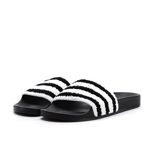 new concept 51fd6 731eb Adidas Men Adilette black core black footwear white Size 5.0 US - Buy  Online in Oman.  Apparel Products in Oman - See Prices, Reviews and Free  Delivery in ...
