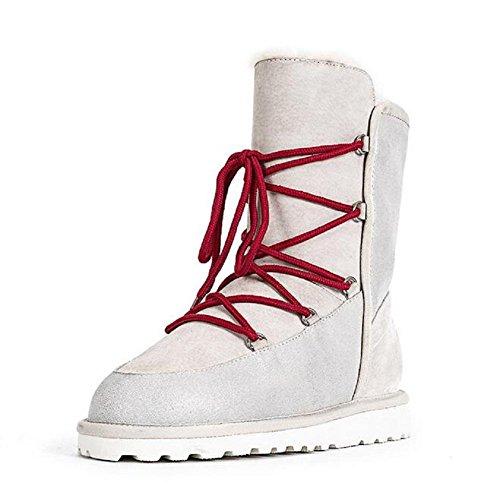 Las mujeres encadenan el tobillo caliente de la nieve calzan el tubo largo más los zapatos calientes del algodón del terciopelo meters white