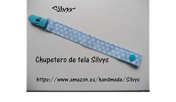 Chupetero de tela con clip Silvys de color azul con lunares ...