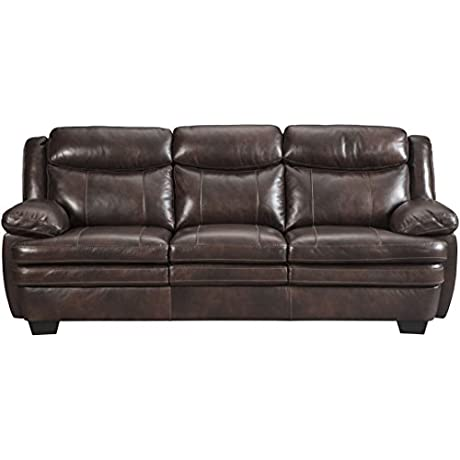 Ashley Hannalore Collection 1530438 90 Sofa With Buttery Soft Cushions Split Back Design Jumbo Stitching Pillow Top Arms And Leather Upholstery In Cafe