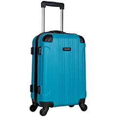 "Pack your essentials for an overnight trip or a weekend getaway inside this durable hardside 4-wheel spinner carry-on suitcase from Kenneth Cole Reaction's ""Out of Bounds"" luggage collection. Loaded with amazing features including a spacious ..."