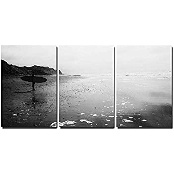 wall26 - 3 Piece Canvas Wall Art - a Man with Surf Board Standing at Beach in Black and White - Modern Home Decor Stretched and Framed Ready to Hang - 24
