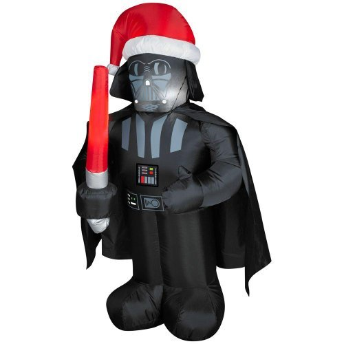 Darth Vader is wearing a Santa hat and holding a red light saber .. He'll make a great addition to any Christmas or Star Wars Collection. Use at home or office.