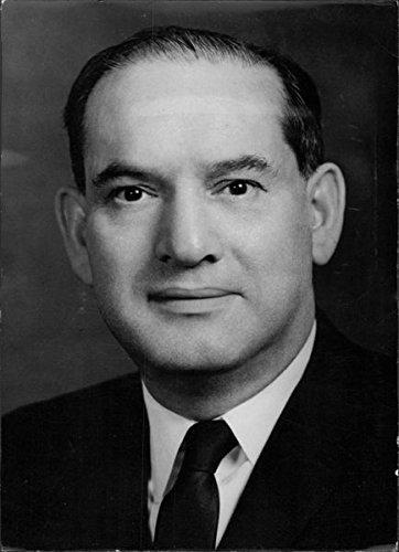 Vintage photo of Avraham Harman smiling.